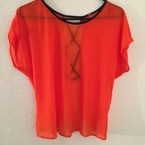 Sheer open back orange blouse
